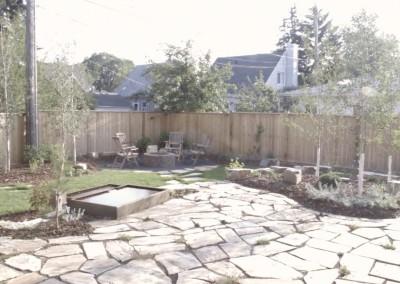 plantbeds and stone walkway
