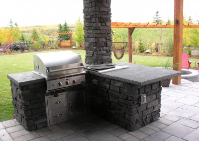 stone bbq setup in backyard