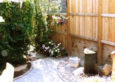 backyard with stone pathway and vegetation