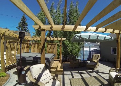 backyard deck with wooden posts and wall