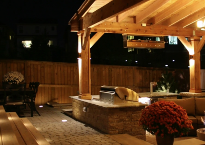 night shot of a redesigned backyard patio area