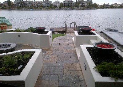 pool and stone fengshui area in backyard by lake at daytime with dock