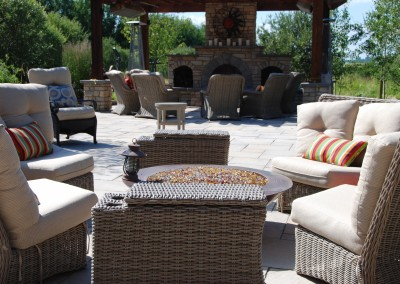 sitting area behind stone fireplace