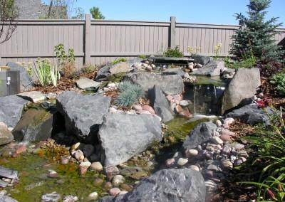 stone waterfall area in backyard