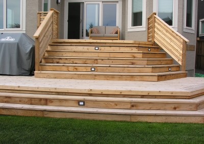 wooden patio steps with lights