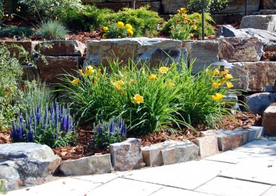 stone fitted plant beds with flowers